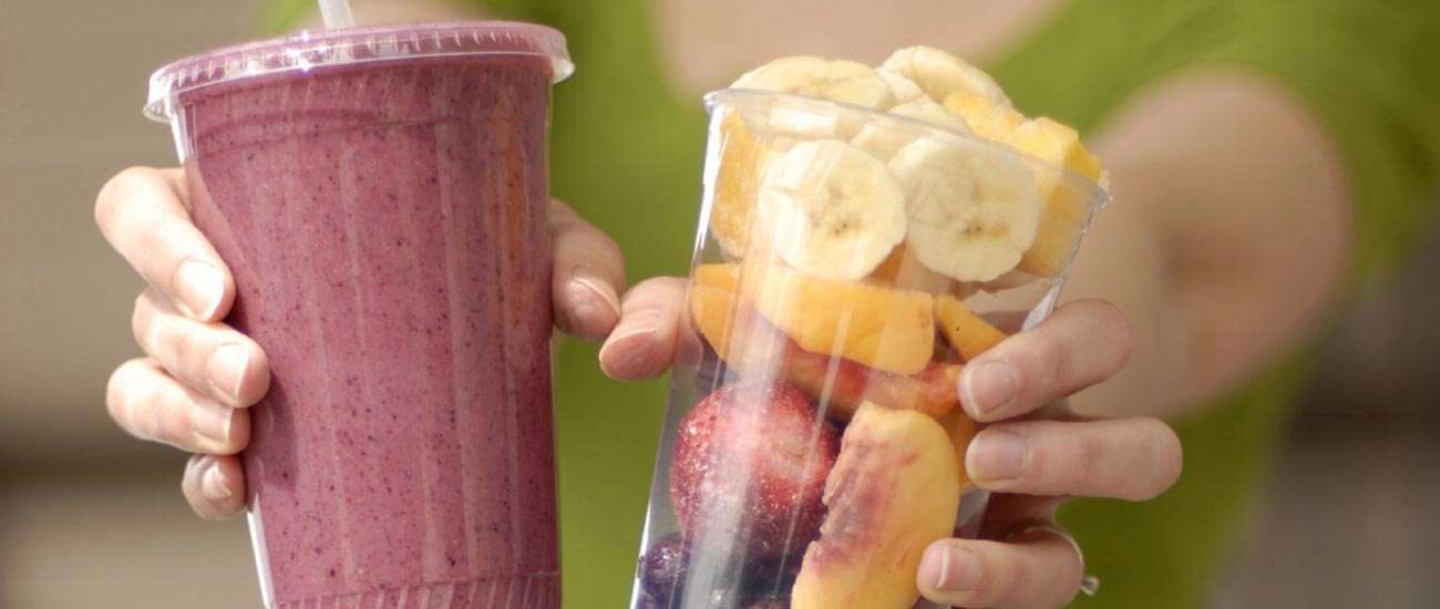 holding fruit smoothies